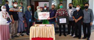 Sekda Takalar Terima Bantuan APD dan Masker dari BNI Mattoanging