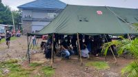 Meski Diguyur Hujan, Serbuan Vaksin TNI AL Dipadati Warga Kota Makassar yang Ingin Divaksin