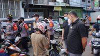 Wakasat Narkoba Polrestabes Pimpin Imbauan PPKM di Pasar Terong