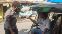 Bhabinkamtibmas Cambayya Rutin Patroli Ingatkan Protkes ke Warga