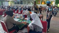 Tim Vaksinator Door to Door Polres Pelabuhan Vaksin Dosis Kedua Pelajar SMPN 5 Makassar